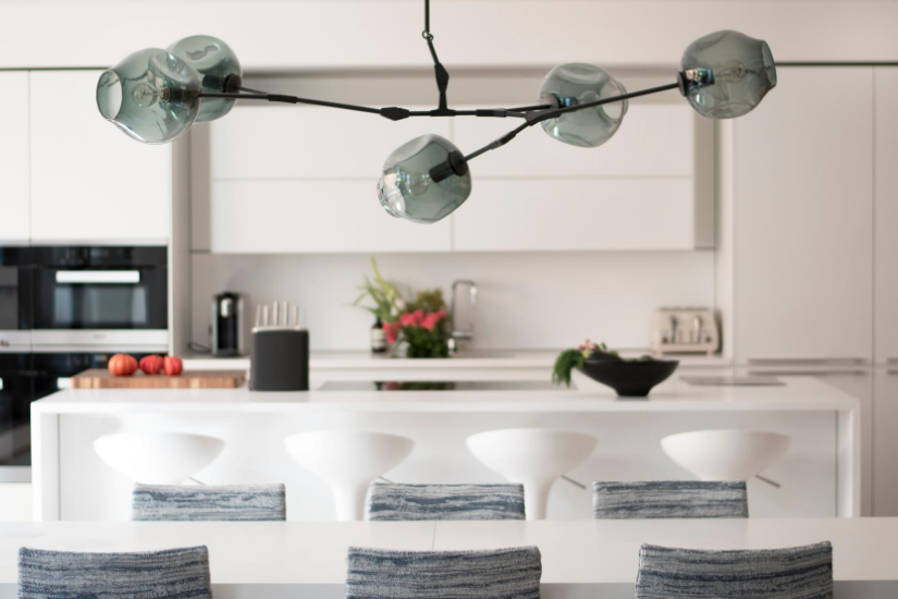 Contemporary glass pendant above dining table